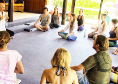 Group of people participating in a healing voice class